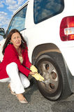 Woman changing car tyre Stock Photo