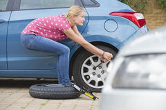 Woman Changing Flat Tyre On Car Stock Photos
