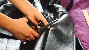 The woman is changing her sheepskin coats. For a sample takes a spring coat. The woman is changing her sheepskin coats. For a sample takes a spring coat stock video