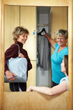 Woman in changing room Stock Photos