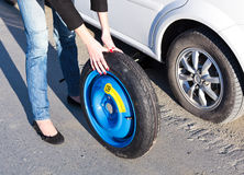 Woman changing the wheel Stock Photography
