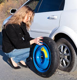 Woman changing the wheel Royalty Free Stock Photo