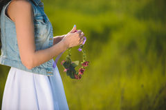 Woman with Chaplet in Field. Woman with chaplet in green field Royalty Free Stock Image