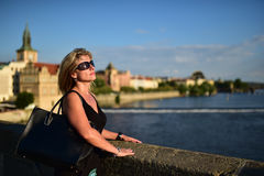 Woman on the Charles Bridge. Nice woman on the Charles Bridge - Prague CZ, late afternoon. View on the river Vltava stock images