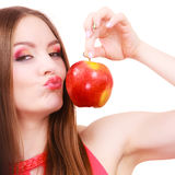 Woman charming girl colorful makeup holds apple fruit Stock Photography