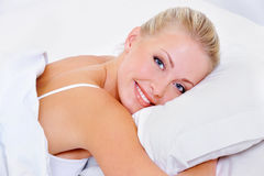 Woman with charming smile after sleeping. Beautiful pretty nice woman with charming smile after sleeping Royalty Free Stock Photos