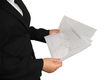 Woman with Chart. A woman in business suit holds a chart in her hand Royalty Free Stock Images