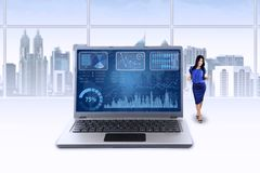 Woman and chart on laptop celebrate her achievement Stock Photography