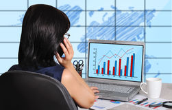 Woman and chart on screen Royalty Free Stock Photo
