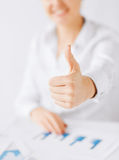 Woman with charts, papers and thumbs up Royalty Free Stock Photos