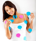 Woman with chat bubbles Stock Photo