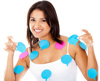 Woman with chat bubbles Stock Photos