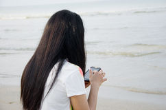 The woman is chating even she go to the beach Stock Images