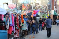 Woman Chats with Clothing Vendor at Colorful Mexican Street Festival in Chicago Royalty Free Stock Photography