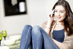 Woman chatting on her mobile phone Royalty Free Stock Images