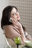 Woman chatting on her mobile phone Royalty Free Stock Image