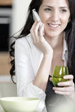 Woman chatting on her mobile phone Stock Image