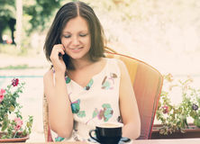 Woman chatting on her mobile phone Stock Photography