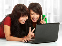 Woman chatting on laptop. Two pretty women having a online chat using webcam Royalty Free Stock Images