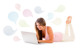 Woman chatting on a laptop Stock Photo