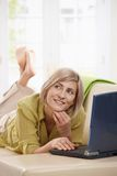 Woman chatting online on computer Royalty Free Stock Image