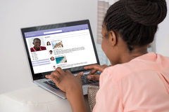 Woman Chatting On Social Networking Site Stock Photo