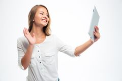 Woman chatting via video call and greeting Stock Photography