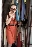 Woman check her clothes before shopping. Royalty Free Stock Photography