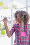 Woman with check shirt drawing on flowchart with marker Royalty Free Stock Image