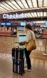 Woman Check in Using Computer at Changi Airport Stock Photos