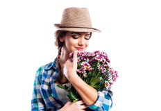 Woman in checked shirt holding bouquet of chrysanthemum flowers Royalty Free Stock Photo