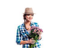 Woman in checked shirt holding bouquet of chrysanthemum flowers Royalty Free Stock Images