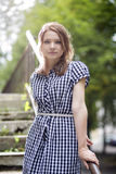 Woman in checkered dress posing Royalty Free Stock Photos