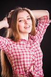 Woman in checkered shirt Royalty Free Stock Image