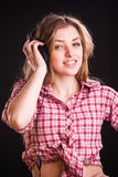 Woman in checkered shirt Royalty Free Stock Images