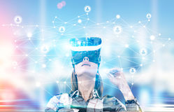 Woman in checkered shirt in vr glasses royalty free stock images