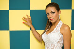 Woman with checkered wall Royalty Free Stock Photography