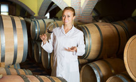 Woman checking ageing process of wine Royalty Free Stock Photography