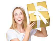 Woman checking the big gift box Stock Images