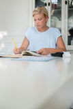 Woman checking bills and doing budget Royalty Free Stock Photos
