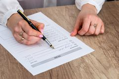 Woman checking completed in to-do list. At office Stock Photo