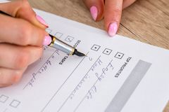 Woman checking completed in to-do list. At office Royalty Free Stock Photo
