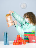 Woman checking content presents boxes Stock Photo