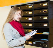 Woman checking correspondence at lobby Stock Photography