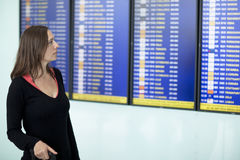 Woman checking destination board at the airport Royalty Free Stock Photography