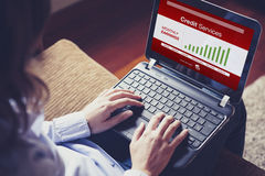 Woman checking earnings by Online Banking. Typing on the keyboar Stock Photo
