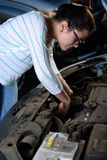 Woman checking engine Stock Image
