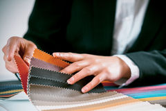 Woman checking fabric color swatches Royalty Free Stock Image
