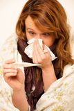 Woman checking feaver with digital termomether girl with flu Royalty Free Stock Images
