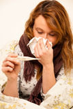 Woman checking feaver with digital termomether girl with flu Royalty Free Stock Image